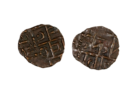 capital gains: Ancient coins from the kingdom of Bhutan in Asia.