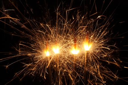 detonation: Macro photo of firework sparkles with black background.