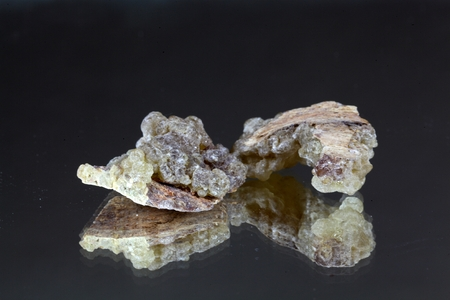 resin: Pieces of natural frankincense resin on a mirror. Stock Photo
