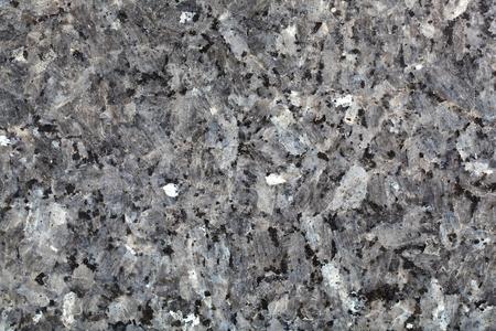 labradorite: Macro photo of the surface of a labradorite containing magmatic rock.