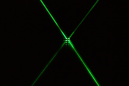 Reflection of a green laser on a mirror. Stock Photo