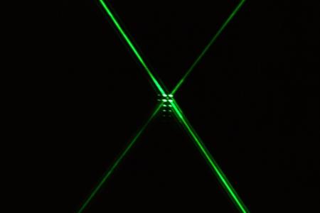 Reflection of a green laser on a mirror. Archivio Fotografico