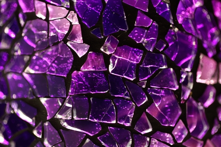 splinter: Purple glass fragments with a metal frame and backlight illumination.