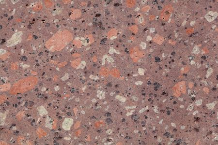 stone volcanic stones: Surface of a porphyry rhyolite rock from central Europe, Saxony-Anhalt. The rock contains fragments of feldspars, quartz and amphibole minerals in a fine grained matrix.