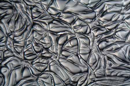 celulosa: Las fibras de acetato de celulosa en el microscopio. El acetato de celulosa es un material sintético que se usa para películas analógicas, filtros para cigarrillos, vasos y muchas otras cosas.