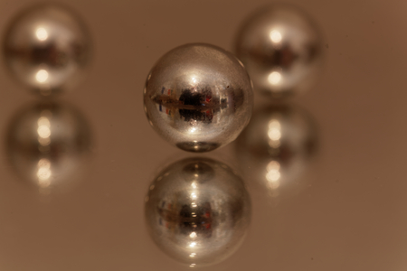 metalic texture: Macro photo of steel balls on a mirror. Stock Photo