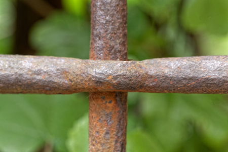 Detail of an rusty ancient iron grid