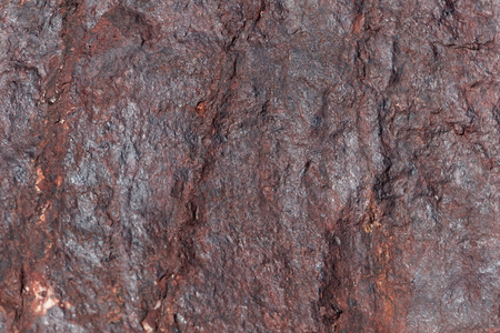 The surface of a sandstone covered by iron oxides.