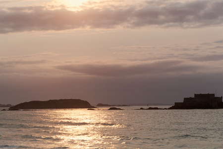 The coast of Saint Malo at sunset, in the NormandyFrance. Stock Photo