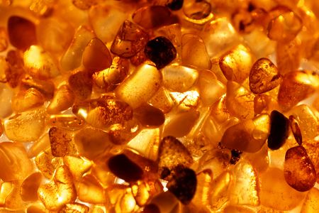 Amber grains with backlight illumination as texture or background.