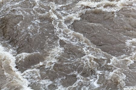 The surface of bubbling brown and dirty water. Stok Fotoğraf