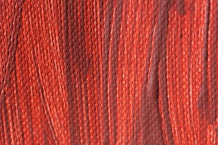 Macro photo of red color of a painting on canvas. Stock Photo