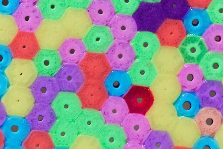 Macro photo of different colored plastic beads as background or texture. Stock Photo