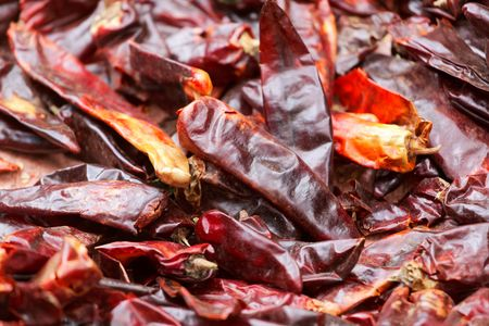 Red pepper fruits prepared for air drying, as background. Reklamní fotografie
