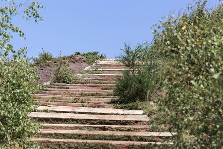 Wooden steps in the mountains of the Massif Central in Southern France. Фото со стока