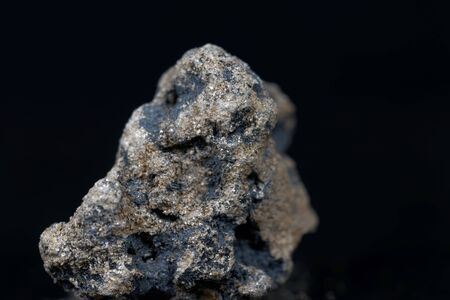 A macro photo of calcium carbide or calcium acetylide with a black background. Imagens