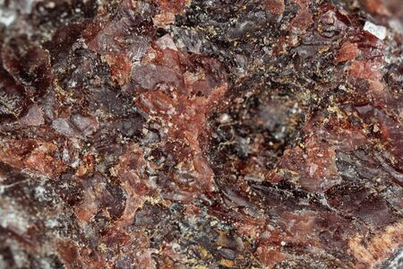 Macro photo of the surface of Kala namak, a black and kiln-fired rock salt used in South Asia as spice.