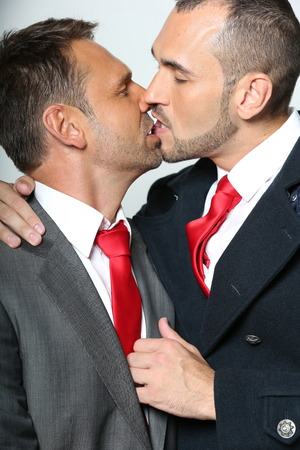 Gay couple kissing photo