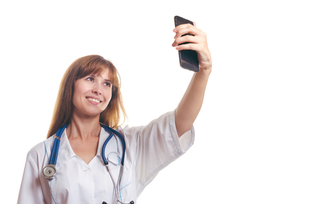 The woman the doctor does the selfie by phone and smiles Stock fotó