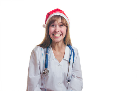 The young doctor in the New Year's cap and a white dressing gown terribly laughs. New year. Christmas. Stock fotó