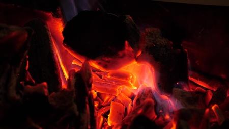 Smoldering glowing bright red fire coals. Archivio Fotografico