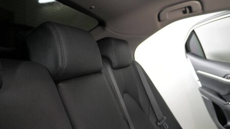 beautiful leather car interior design. luxury leather seats in the car. Black leather seat covers in the car. artificial leather rear seats in the car.