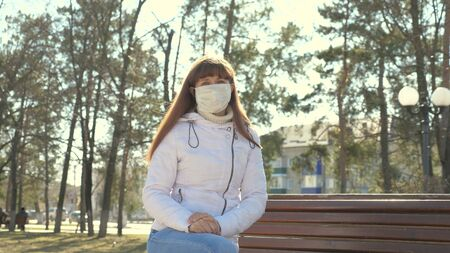 Pandemic Coronavirus. portrait of a young tourist woman wearing protective mask on street crowd people. concept health and safety, N1H1 coronavirus, virus protection. antivirus protection concept Standard-Bild