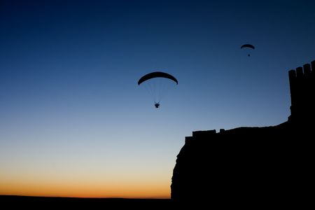 Photo taken in the province of Albacete at the dusk, near a castle in which a group of sportsmen was practicing the paragliding photo