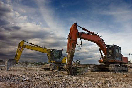 flatten: Two bulldozers parked in a blowned building Stock Photo