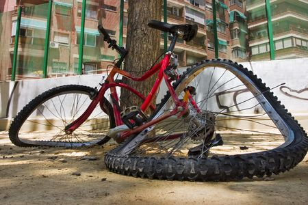 bicycle race: Close up photo of a bicycle totally broken in the floor. Stock Photo