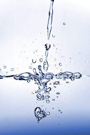 Blue tinted water splash, full of bubbles and waves. Stock Photo - 1518544