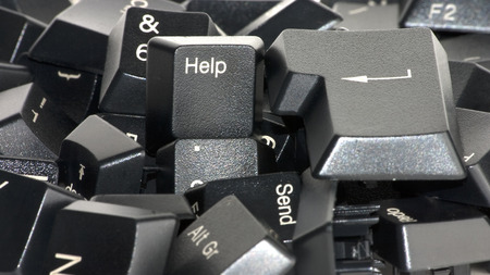 confirm confirmation: Help key mixed in a lot of keys from a black keyboard.  Stock Photo