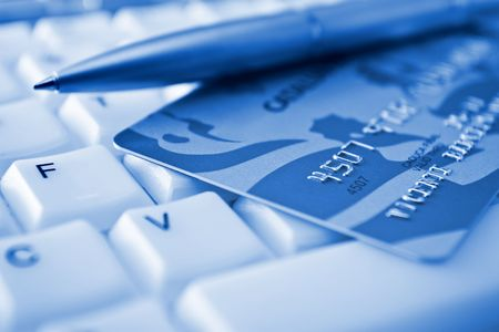 internet fraud: Credit card over a keyboard