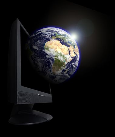 Monitor with an earth globe growing from it.This is a photoshop edited image. Some components of this montage are provided courtesy of NASA, and have been found at http:visibleearth.nasa.gov photo