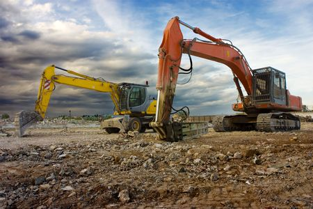 Heavy machines in a construction site ready to work. Stock Photo - 3572851