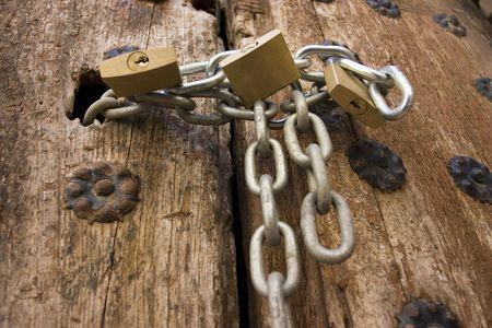 Old wooden door closed with a padlock photo