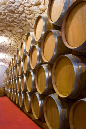 Interior of a wine cellar with a production of full barrel of wine closed Stock Photo