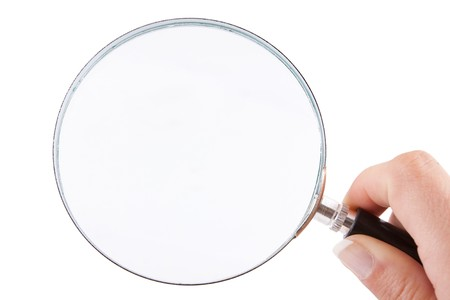 Female hand holding a magnifying glass  isolated against a white background Stock Photo