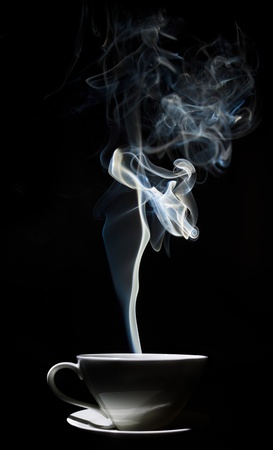 White cup of coffee with a dense smoke in the air, against a black background.