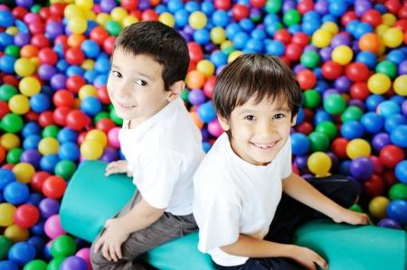 Happy children playing together and having fun Standard-Bild