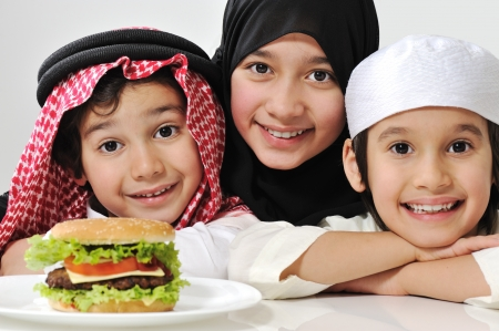 middle eastern families: Arabic family children with burger Stock Photo
