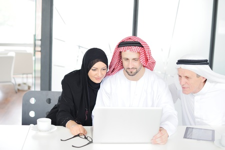 Successful and happy business arabic people sitting for a meeting photo