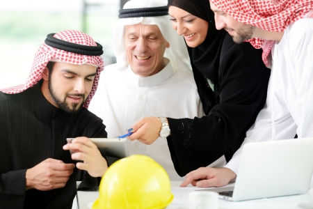 headcloth: Successful and happy business arabic people sitting for a meeting