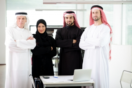 Successful and happy business arabic people standing for a meeting photo