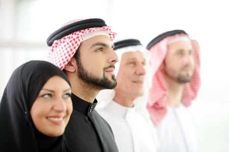 arabic man: Successful and happy business arabic  people looking up
