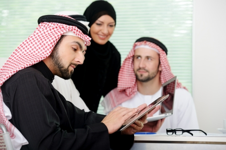 gcc: Business arabic people meeting indoor with electronic tablet