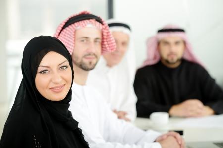 gcc: Successful and happy business arabic people sitting for a meeting