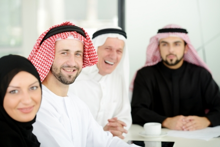 gcc: Successful and happy business people sitting for a meeting