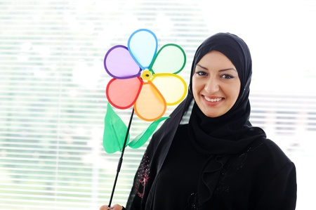 muslim girl: Arabic muslim woman is smiling with a healthy teath Stock Photo