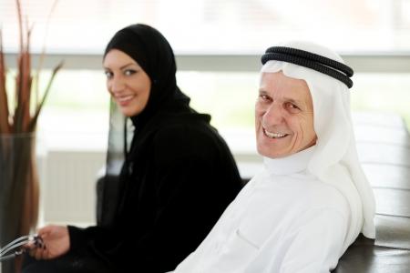 arab model: Two couple muslim  on office